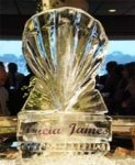 Ice sculpture of a sea shell with the names of the bride and groom