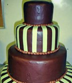 Chocolate grooms cake with lime green verticle strips