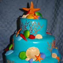Sandcastle wedding cake with starfish