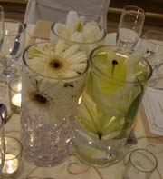 cheap wedding idea of flowers in glasses