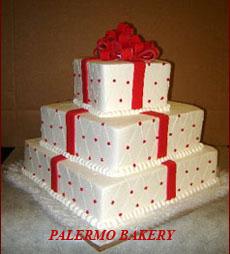 Christmas wedding decoration ideas of a christmas wedding cake made to look like a present