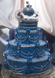 Disney Wedding Cakes, Blue Wedding Cake with a Cinderella Coach as a Topper