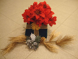 Christmas centerpiece present with flowers
