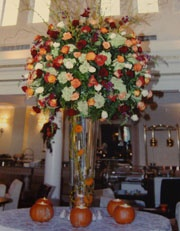 Wedding centerpiece with fall colored flowers