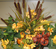 Fall wedding themes centerpiece of fall flowers