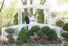Garden wedding ideas on a bridge over a pond