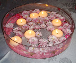 Centerpiece of bowl with floating candles