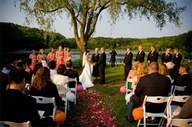 Outdoor ceremony with flowers down the aisle