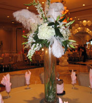 Ostrich feathers with flowers as your bridal centerpiece