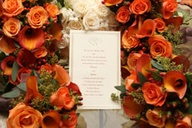 Invitation surrounded by orange flowers