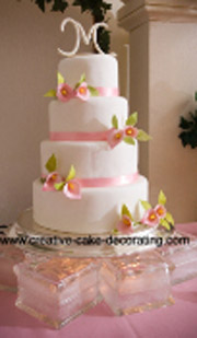 Beautiful four tier cake designs with initial cake topper