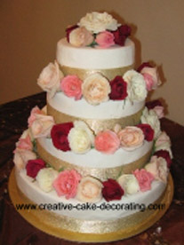 Beautiful four tier wedding cake designs with fresh roses