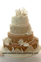 Gorgous multi colored tiered beach theme wedding cake