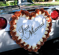 Wedding car decorations with a Just Married sign
