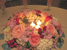 Stunning centerpieces candle surrounded by flowers