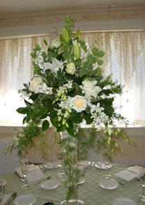 Wedding flower centerpieces of white flowers