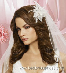 Wedding hairstyles for curly hair with a flower