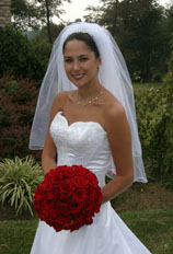 Bride with bouquet of rosses