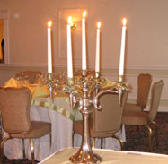 Halloween wedding theme of tall candles as a centerpiece
