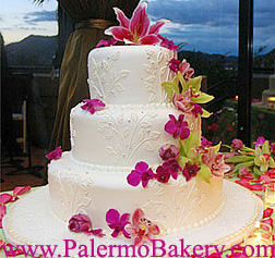 Gorgeous beach themed cake with tropical flowers
