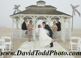 Bridal couple in gazebo  on the beach