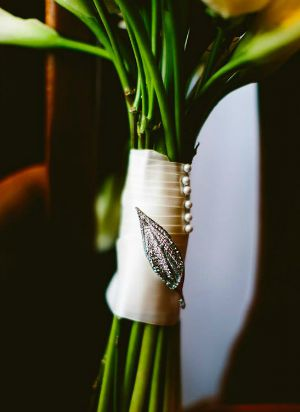 Rhinestone Brooch added to decorate a calla lily wedding bouquet