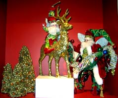 Christmas centerpiece depicting Santa and a reindeer for a Wedding Table Arrangement