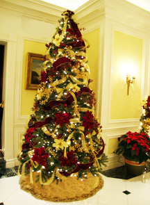 Christmas wedding ideas decorating the reception hall with Christmas trees