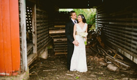 Bride and Groom in a barn for their country wedding ideas