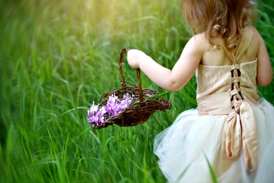Country Wedding Ideas - Flower girl carrying a basket of hand picked flowers