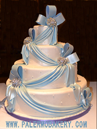 Elegant  wedding cake with light blue fondant draping for the perfect wedding