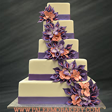 Stunning and elegant wedding cake with purple and orange flowers