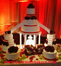 Elegant tiered wedding cake with lots of flowers