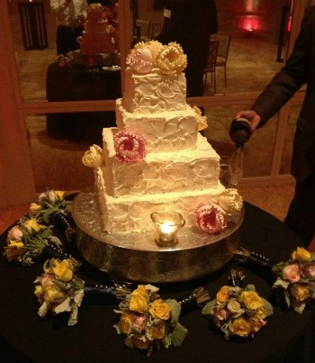 Cake with beautiful fall colored flowers.