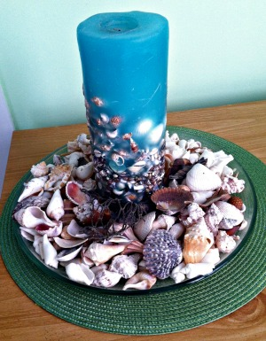 Blue Candle and Seashells for an Inexpensive Centerpiece