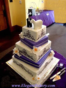 Beautiful square wedding cake with alternating white and purple tierspurple