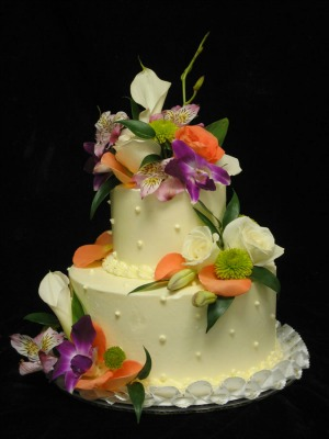 Beautiful tropical theme cake with orchards, roses, calla lilies and mums