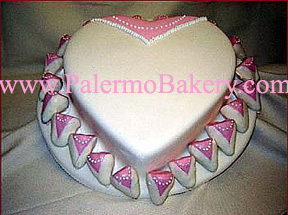 Wedding cake shaped like a heart photo