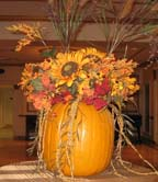 Carved out pumpkin centerpieces with sunflowers