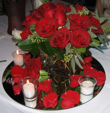 Centerpiece on a mirror with candles