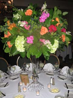 Stunning centerpieces with a tall clear vase