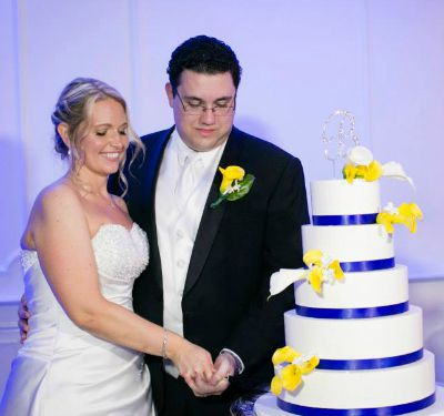 Wedding Colors Theme - Bride and Groom Cutting the Cake