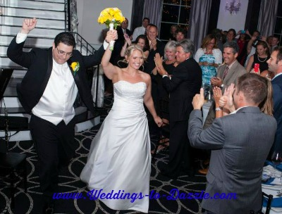 Wedding Photography Poses Bride and Groom Entering Reception