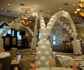 Balloon arches are fun wedding decor ideas for the reception
