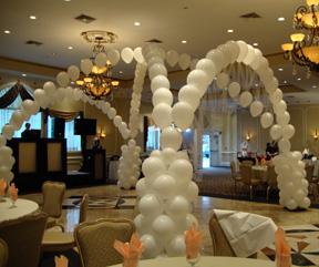 Balloon arches are fun wedding decor ideas for the reception