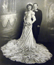This is an example of a 1940s wedding theme dress and headpiece.
