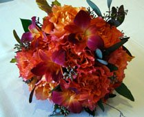Wedding bouquet with red, brown and maroon flowers