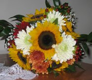 Beautiful autumn bridal bouquet with sunflowers