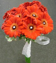 Fall wedding bouquet of long stem organge flowers