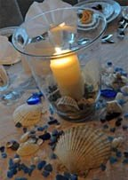 Beach candle with seashells